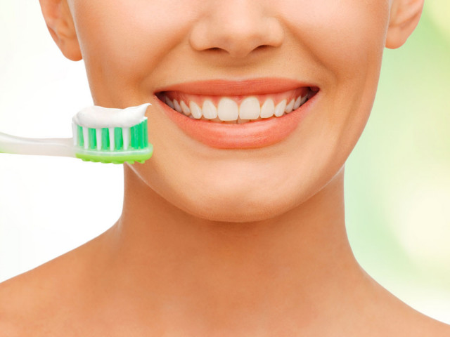 pulire apparecchio denti